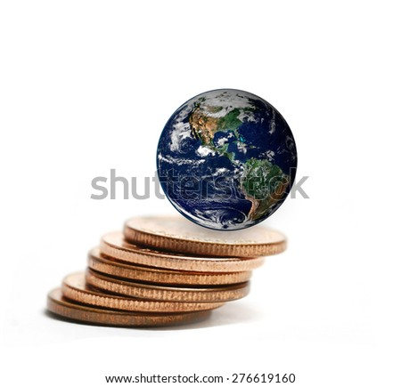 the earth on coins stacked ,including elements furnished by NASA - stock photo