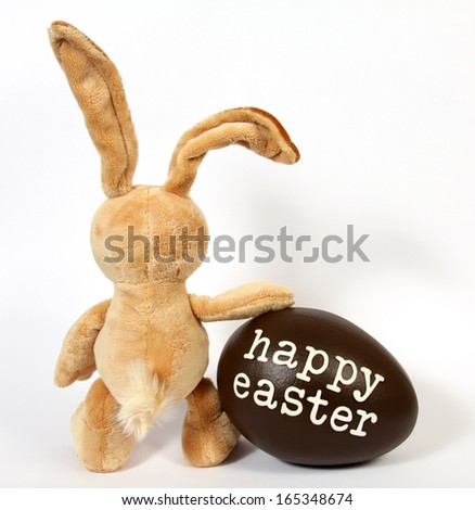The Easter Bunny with Egg with the inscription: Happy Easter - stock photo