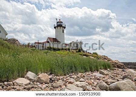 The Eastern Point Lighthouse serves the Gloucester Harbor in Massachusetts. - stock photo