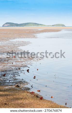 The ebb tide sea beach in summer - stock photo