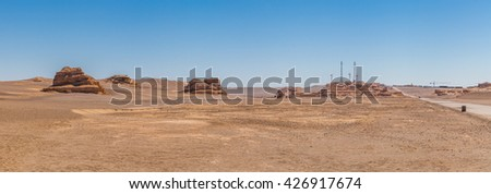 The Echoing-Sand Mountain, a natural wonder in the Gobi Desert, south of the Dunhuang city, Gansu Province, Western China. - stock photo