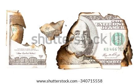 The economic crisis is burning hundred dollar - stock photo