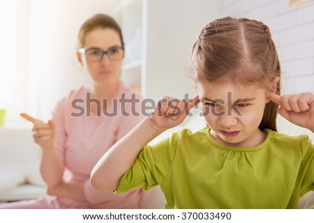 the education of the child. mother scolds her child girl. family relationships - stock photo
