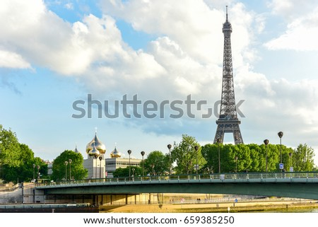 The Eiffel Tower, a wrought iron lattice tower on the Champ de Mars in Paris, France.