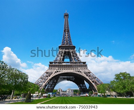 The Eiffel Tower against a blue sky - stock photo