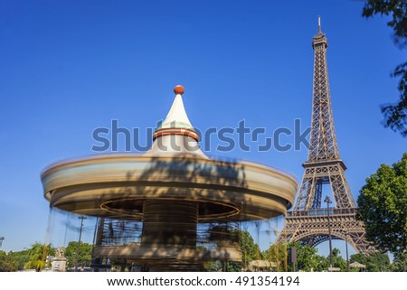 The Eiffel Tower and a French Merry-Go-round. on the Champ de Mars in Paris, France.