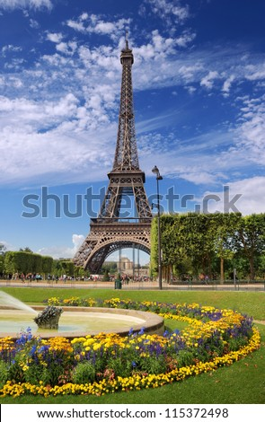 The Eiffel tower and flowerbed on Champ de Mars in Paris, France.