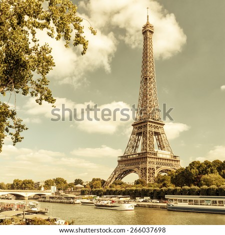 The Eiffel tower from the river Seine in Paris, France. Vintage photo. - stock photo