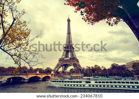 The eiffel tower in paris, while a boat cruise along the Seine - stock photo
