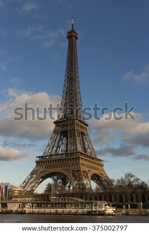 The Eiffel tower is a wrought lattice tower on the Champs de Mars in Paris. The tower is the tallest structure in Paris and the most visited monument in the world.