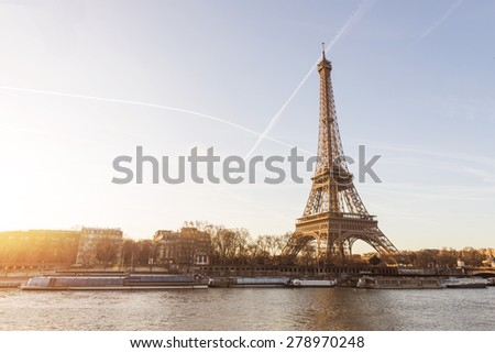 The Eiffel Tower is one of the world's most famous landmark. It is also one of the most visited place in Paris, France. - stock photo