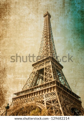 The Eiffel Tower (nickname La dame de fer, the iron lady),The tower has become the most prominent symbol of both Paris and France - stock photo
