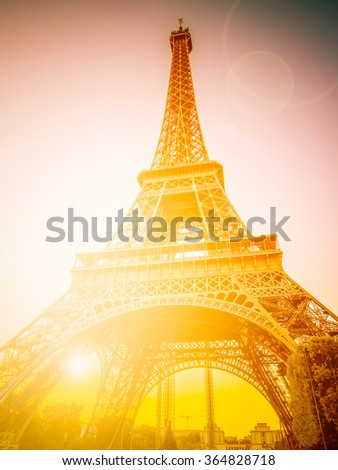 The Eiffel tower, one of the most favorite landmarks in the world with sunlight. Retro filtered. - stock photo
