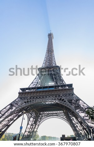 The Eiffel Tower with shadow behind the light of Sun in Summer, Paris, France