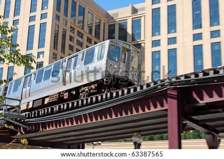 The El. Overhead commuter train in Chicago. - stock photo