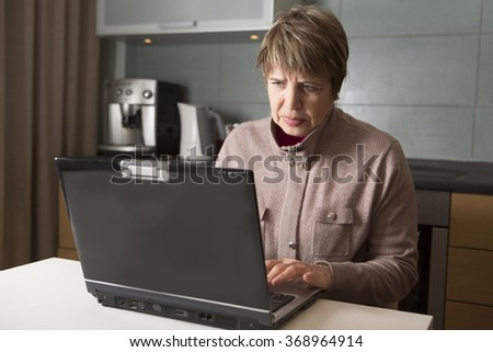 the elderly woman with the laptop