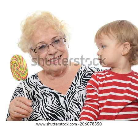 The elderly woman with the little grandson - stock photo