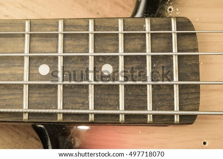 The electric bass finger board with vintage look effect.