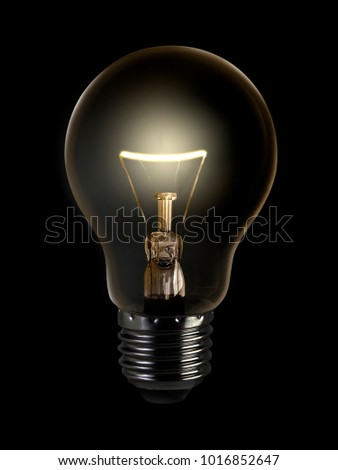 The electric bulb is glowing on a dark background. The concept is a successful idea