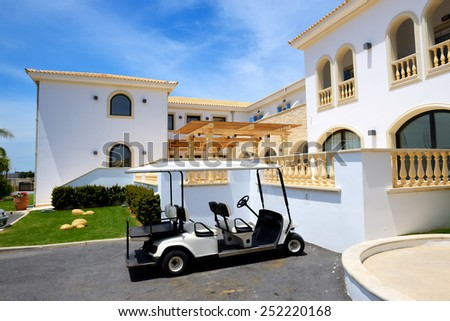 The electric cars for tourists transportation at luxury hotel, Crete, Greece - stock photo