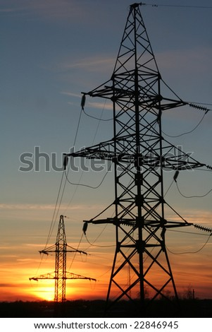 The electrical network against the backdrop of sunset - stock photo