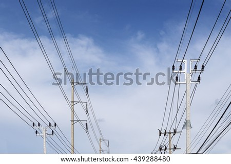 The electricity pole belong the street with the blue sky.The different type of electricity pole with the sky.The concrete electricity post belong the street with the blue sky. - stock photo