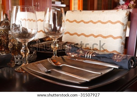 the elegant tableware on a dinner table