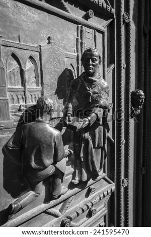 The elements of decor on the facade of the Metropolitan Cathedral of Saints Vitus, Wenceslaus and Adalbert. Black and white. Prague. Czech Republic. - stock photo
