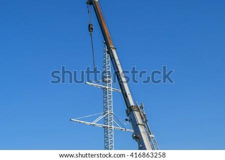 The elevator crane on a truck platform. - stock photo