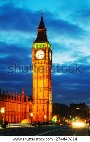 The Elizabeth Tower as seen from the Westminster bridge in the night - stock photo
