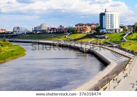 The embankment in Tyumen and the river Tura in the summer sunny day. June, 2015