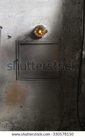 The emergency light from a room in a basement - stock photo