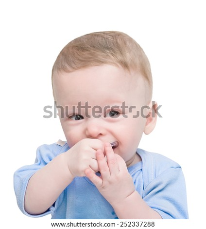 The emotional child with a baby's dummy in hands on the white - stock photo