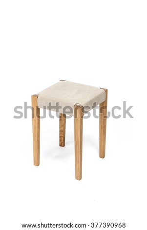 The empty(blank, vacant, hollow) square wood stool with fabric for woman make up with no people close up isolated white at the studio. - stock photo