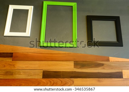The empty frame on the wall.