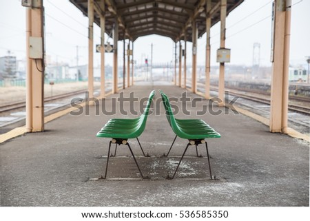 The empty green chair in the train terminal