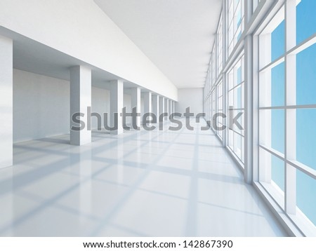 The empty long corridor with large windows