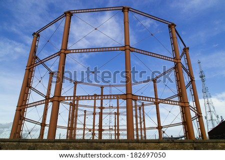 The empty natural gas tank towers in Bolton, England. - stock photo