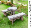 The empty wooden table and bench in garden or park - stock photo