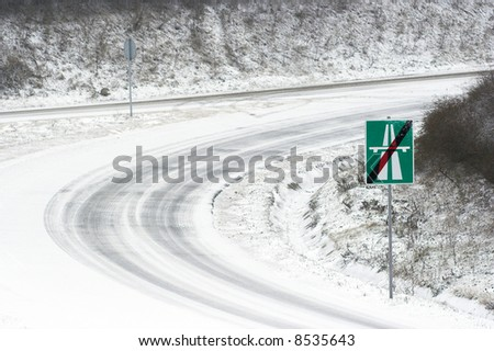 The end of the winter highway - stock photo