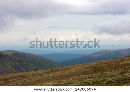 The endless tundra north of Russia against cloudy sky.