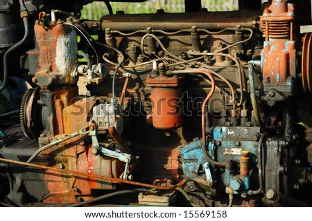 The engine of an old tractor - stock photo