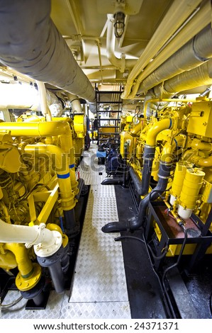The engine room of a tugboat, with the various diesel engines for propulsion - stock photo