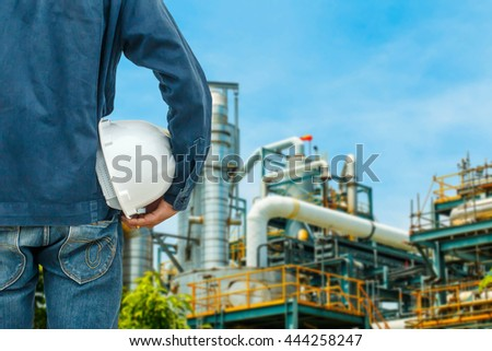 The engineering and safety helmets stood on the details of petroleum refinery
