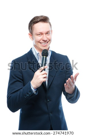 The entertainer. Young elegant talking man holding microphone, Isolated on white. - stock photo
