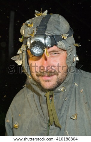 The entomologist observes insects at night. - stock photo