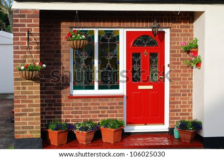 The entrance door of lovely English cottage - stock photo