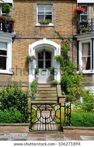 The entrance door to the lovely cottage - stock photo