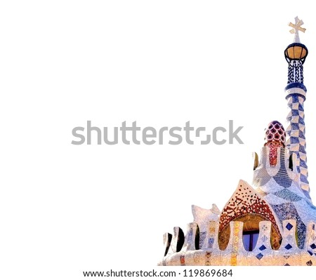 The entrance of  Park Guell in Barcelona with the famous mosaics of Antonio  Gaudi isolated on white - stock photo