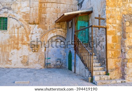The entrance to the Ethiopian Monastery, located on the roof of the Church of the Holy Sepulchre, Jerusalem, Israel. - stock photo